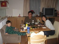 Kenji, Dad, and Takiko at dinner