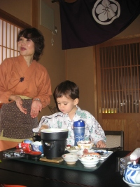 Kenji and attendant at Ryokan